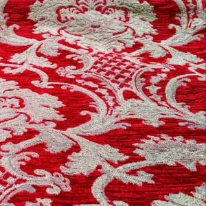 dettaglio tessuto damascato rosso