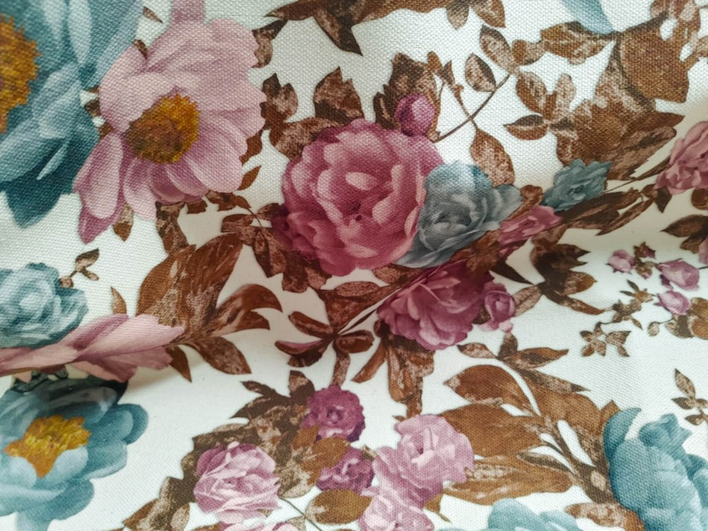 Detail of printed fabric with patterned flowers and leaves