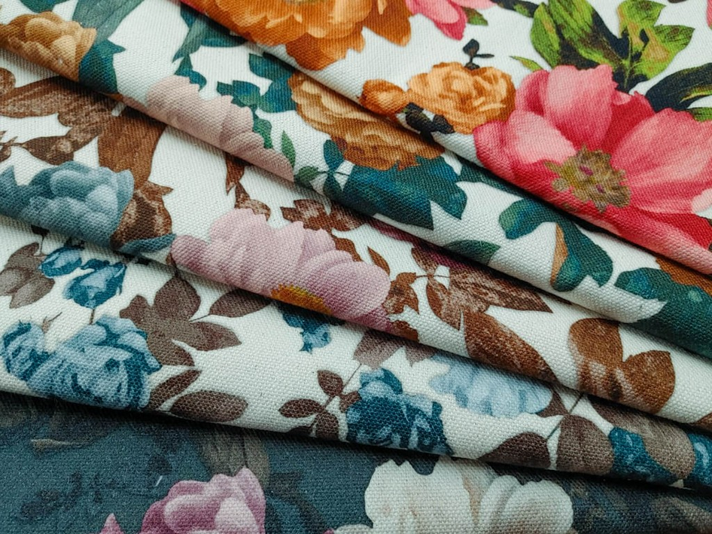 Fabrics printed with flowers of different colours folded and arranged in a fan shape