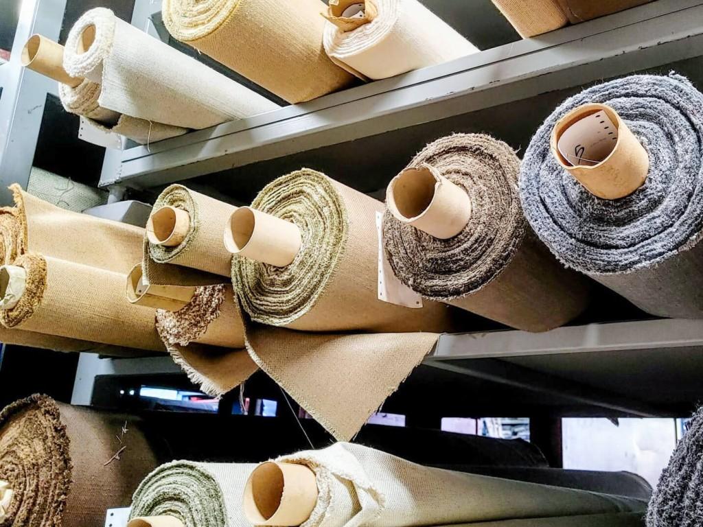 rolls of upholstery fabrics on shelves